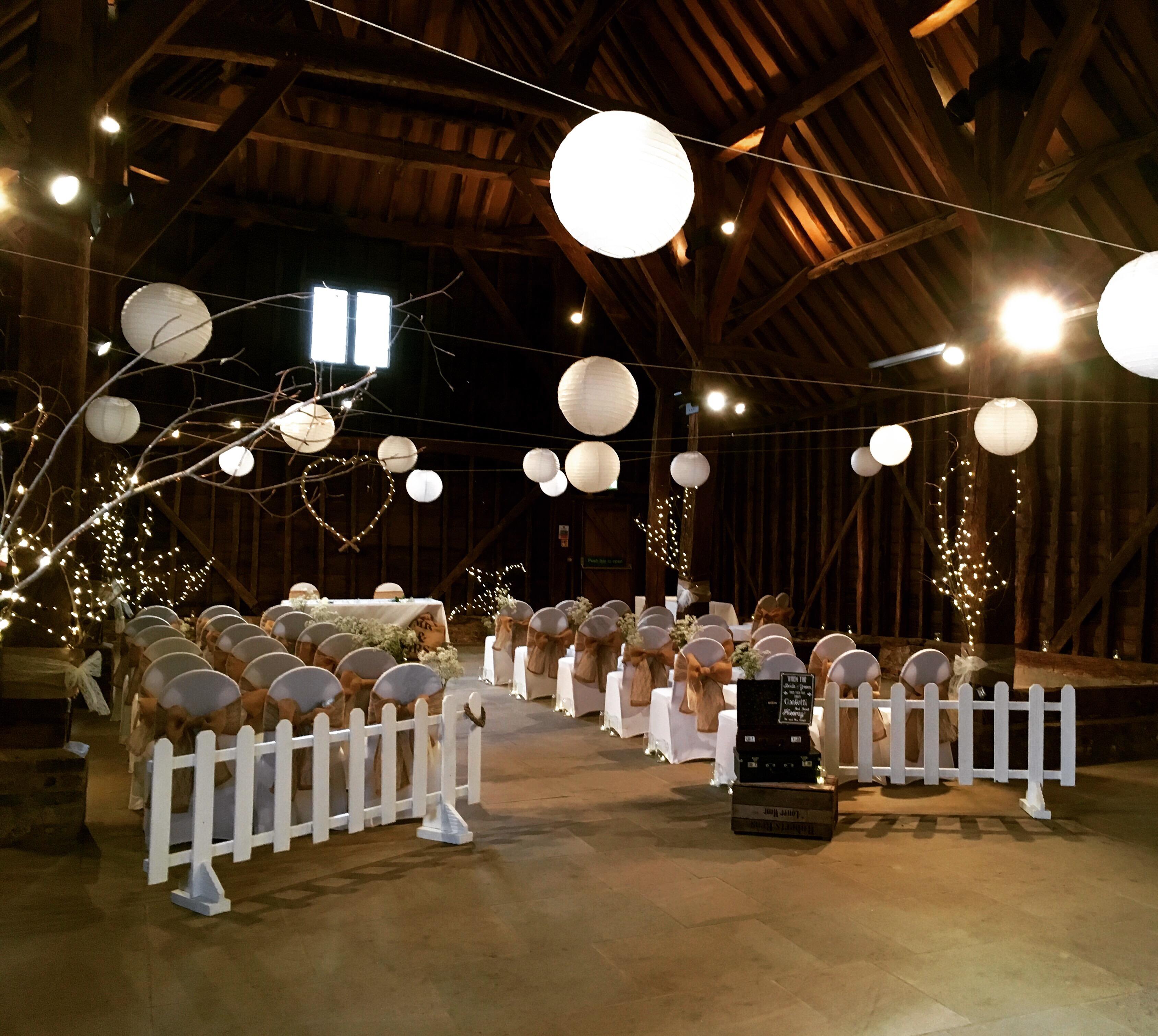 Barn wedding with fairy lights and chair ties