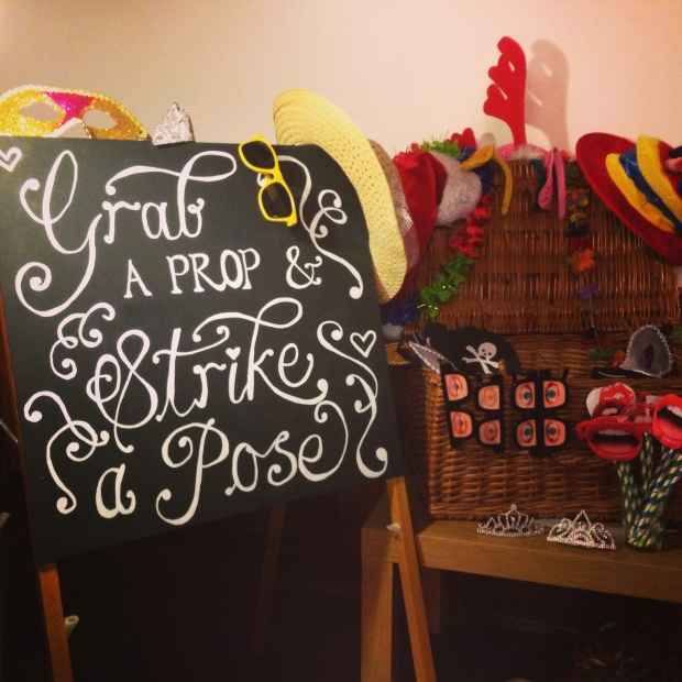 Grab a prop and strike a pose chalkboard and props